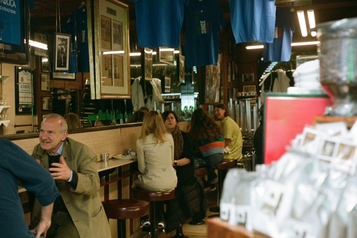 Punters sit inside Bar Italia on Frith Street in Soho