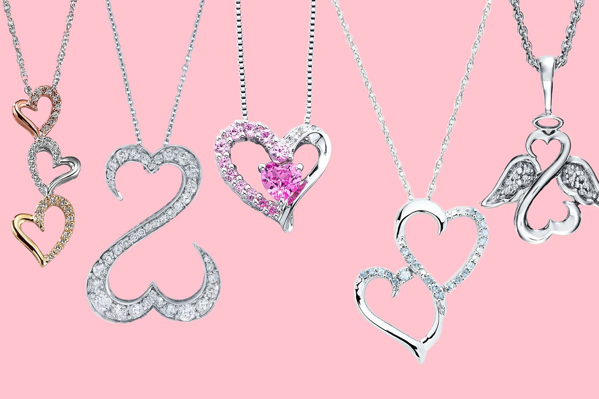 Five heart pendant necklaces on a pink background