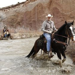 Mark Eaton and his horse, Big Tim, cross the San Rafael River. Knowing where to cross and what to avoid is the key to not just enjoying a ride but walking away unscathed.