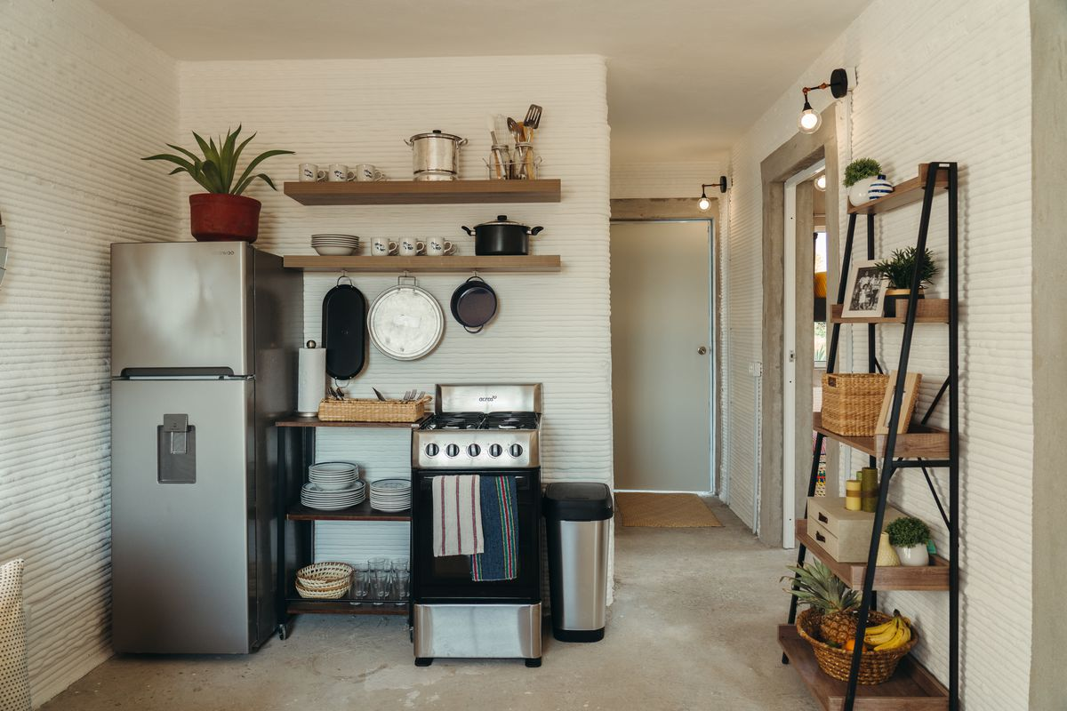 Compact kitchen with small appliances.