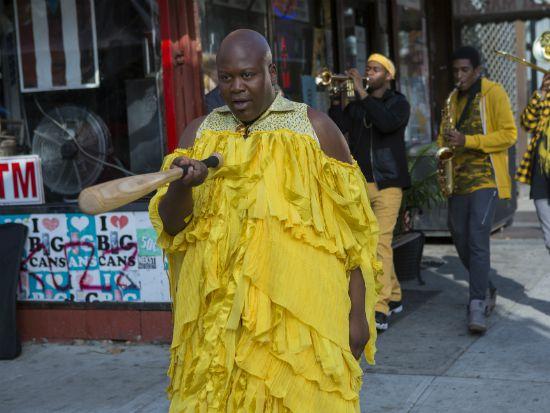 "Titus Burgess wearing the yellow Beyonce dress in ""Unbreakable Kimmy Schmidt"""