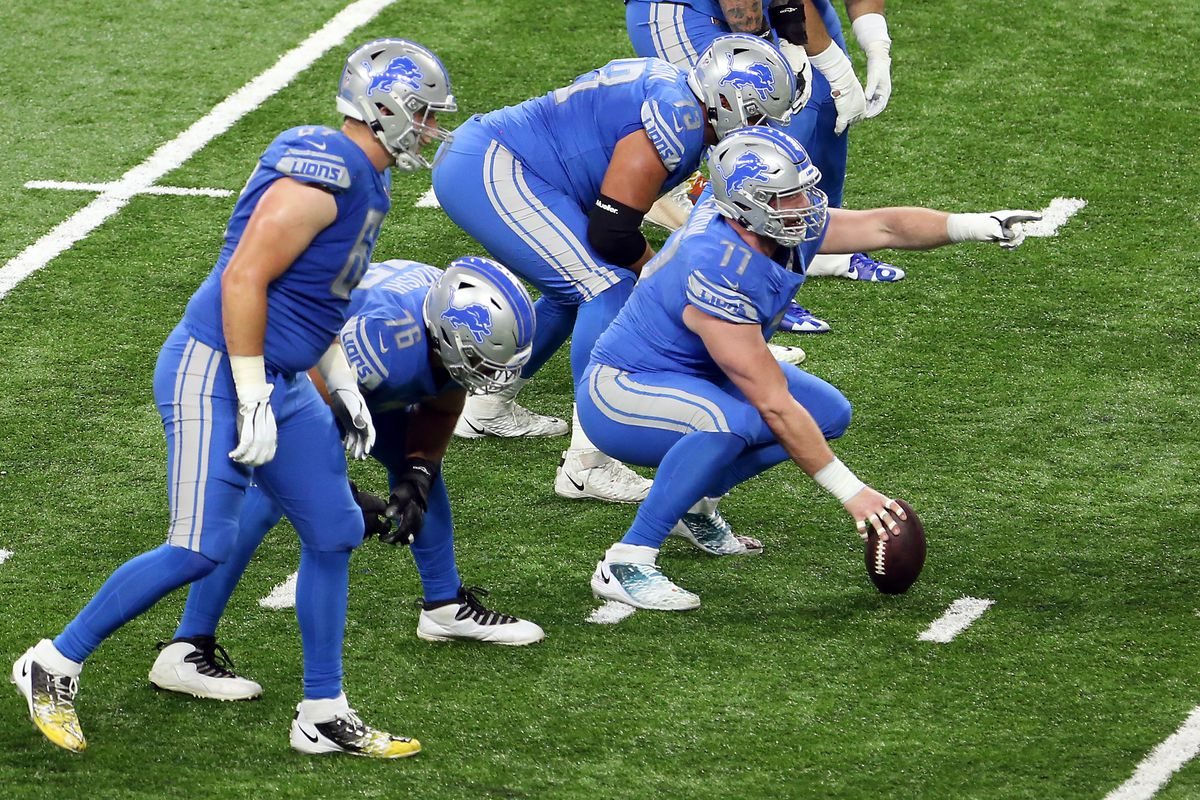 Detroit Lions center Frank Ragnow (77) signals before a play during the first half of an NFL football game between the Green Bay Packers and the Detroit Lions in Detroit, Michigan USA, on Sunday, December 13, 2020.