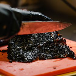 The brisket trimmings are cut into chunks, producing bite-sized morsels of burnt ends.