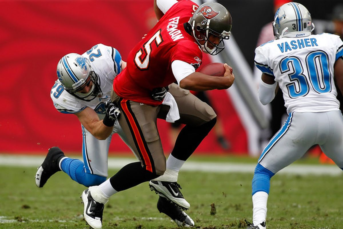 TAMPA FL - DECEMBER 19:  Safety John Wendling #29 of the Detroit Lions tackles quarterback Josh Freeman #5 of the Tampa Bay Buccaneers during the game at Raymond James Stadium on December 19 2010 in Tampa Florida.  (Photo by J. Meric/Getty Images)