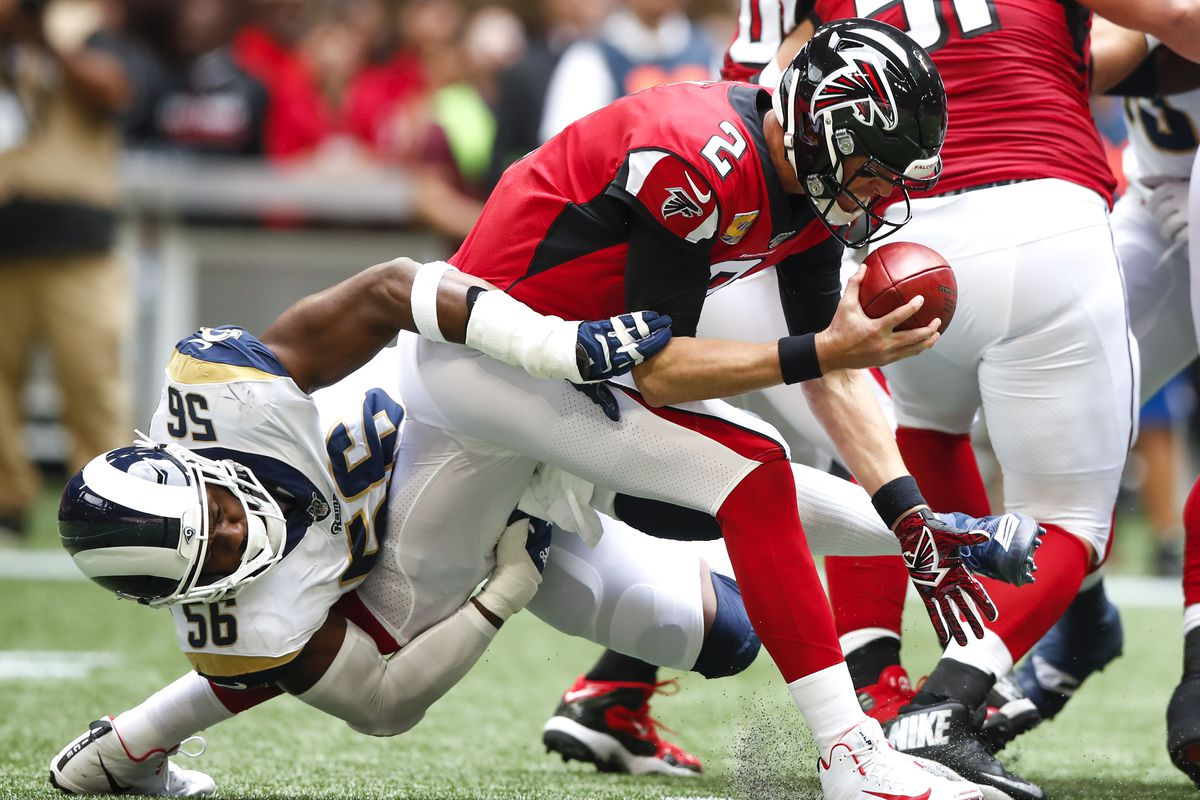 Matt Ryan of the Atlanta Falcons is sacked by Dante Fowler of the Los Angeles Rams in the first half of an NFL game at Mercedes-Benz Stadium on October 20, 2019 in Atlanta, Georgia.