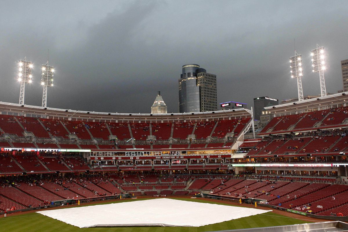 Cincinnati, OH, USA; A general view of the tarp covered field during a rain delay before Tuesday's rainout between the  Cincinnati Reds and the Chicago Cubs at Great American Ballpark. Credit: Frank Victores-US PRESSWIRE