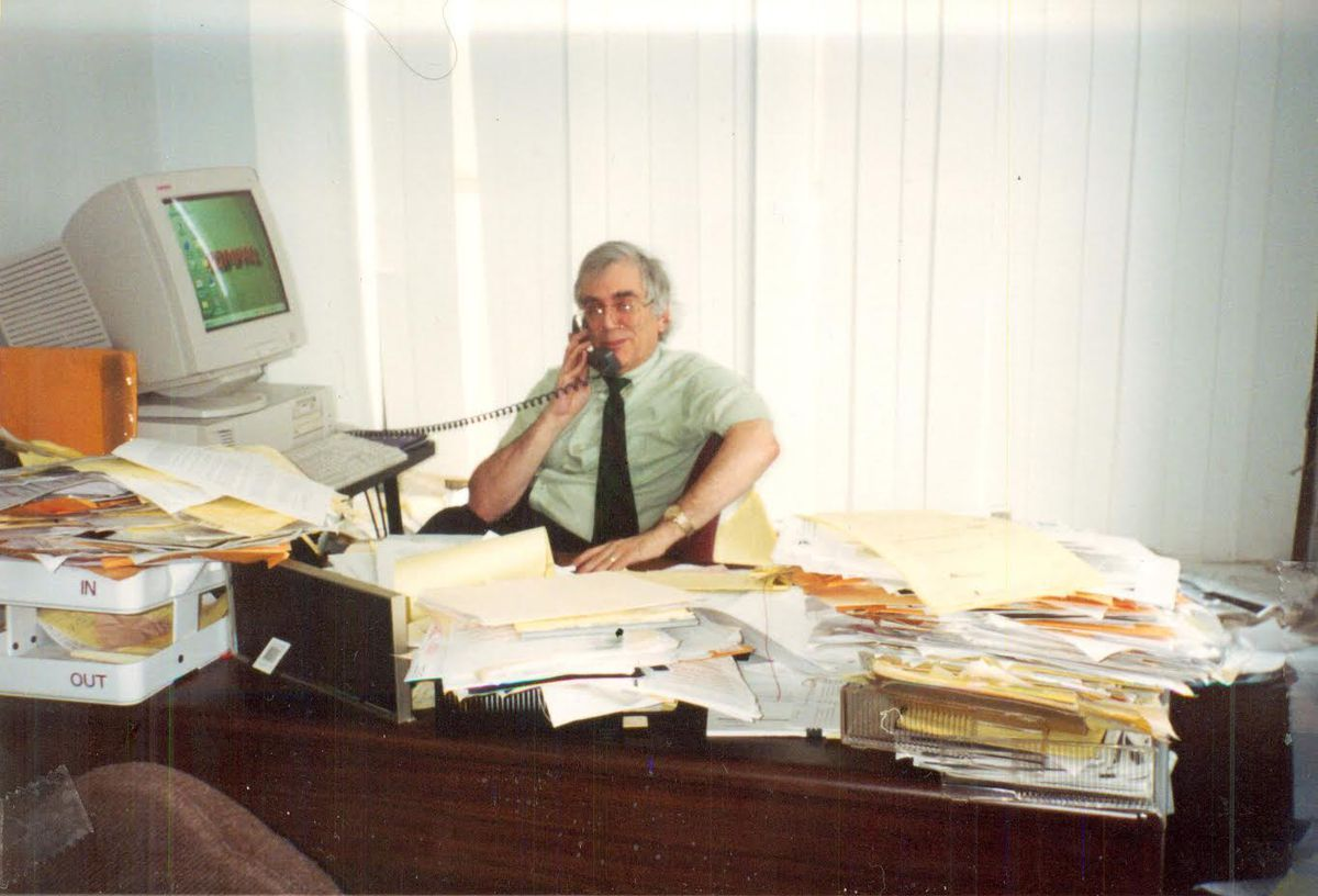 Harold Winston in his office.  Colleagues say he was able to locate any paper he needed among the stacks of documents.