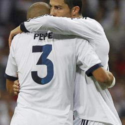Real Madrid's Cristiano Ronaldo from Portugal, right, celebrates his goal with Pepe from Portugal during a Spanish La Liga soccer match against Granada at the Santiago Bernabeu stadium in Madrid, Spain, Sunday, Sept. 2, 2012.