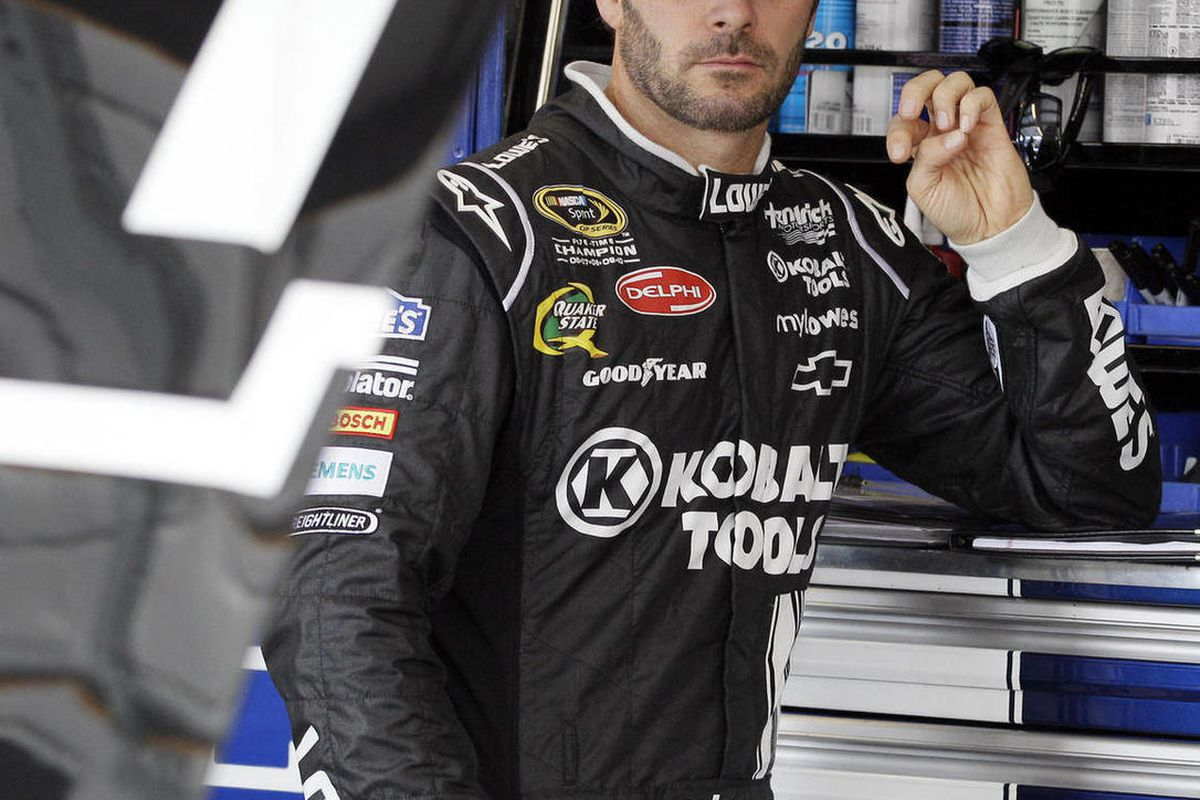 Jimmie Johnson looks at his car in the garage during practice for the NASCAR Sprint Cup Series auto race at Chicagoland Speedway in Joliet, Ill., Friday, Sept. 14, 2012.