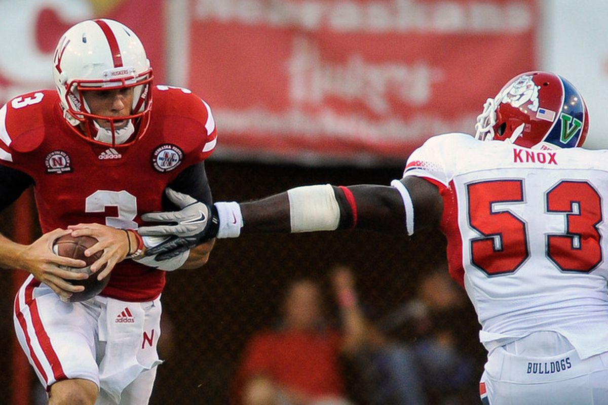 LINCOLN, NE - SEPTEMBER 10: Taylor Martinez #3 of the Nebraska Cornhuskers slips past Kyle Knox #53 of the Fresno State Bulldogs during their game at Memorial Stadium September 10, 2011 in Lincoln, Nebraska. (Photo by Eric Francis/Getty Images)