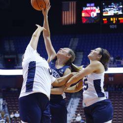 Carla Berube battles for a rebounds with Maria Conlon and Mel Thomas.