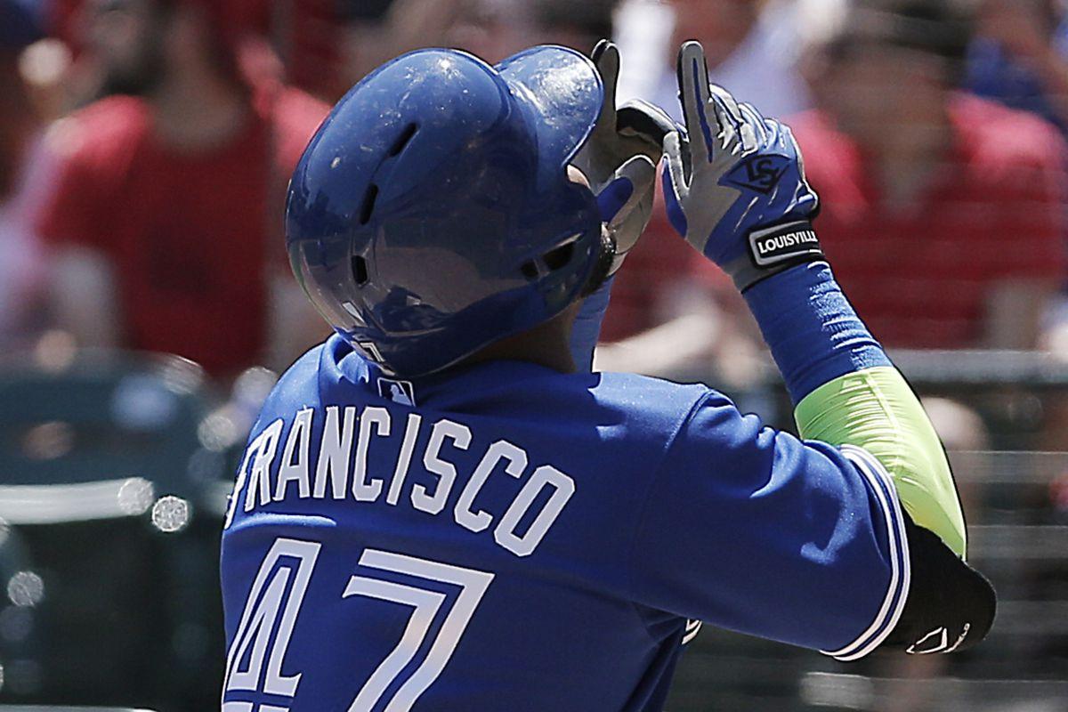 Juan Francisco celebrates after hitting a home run
