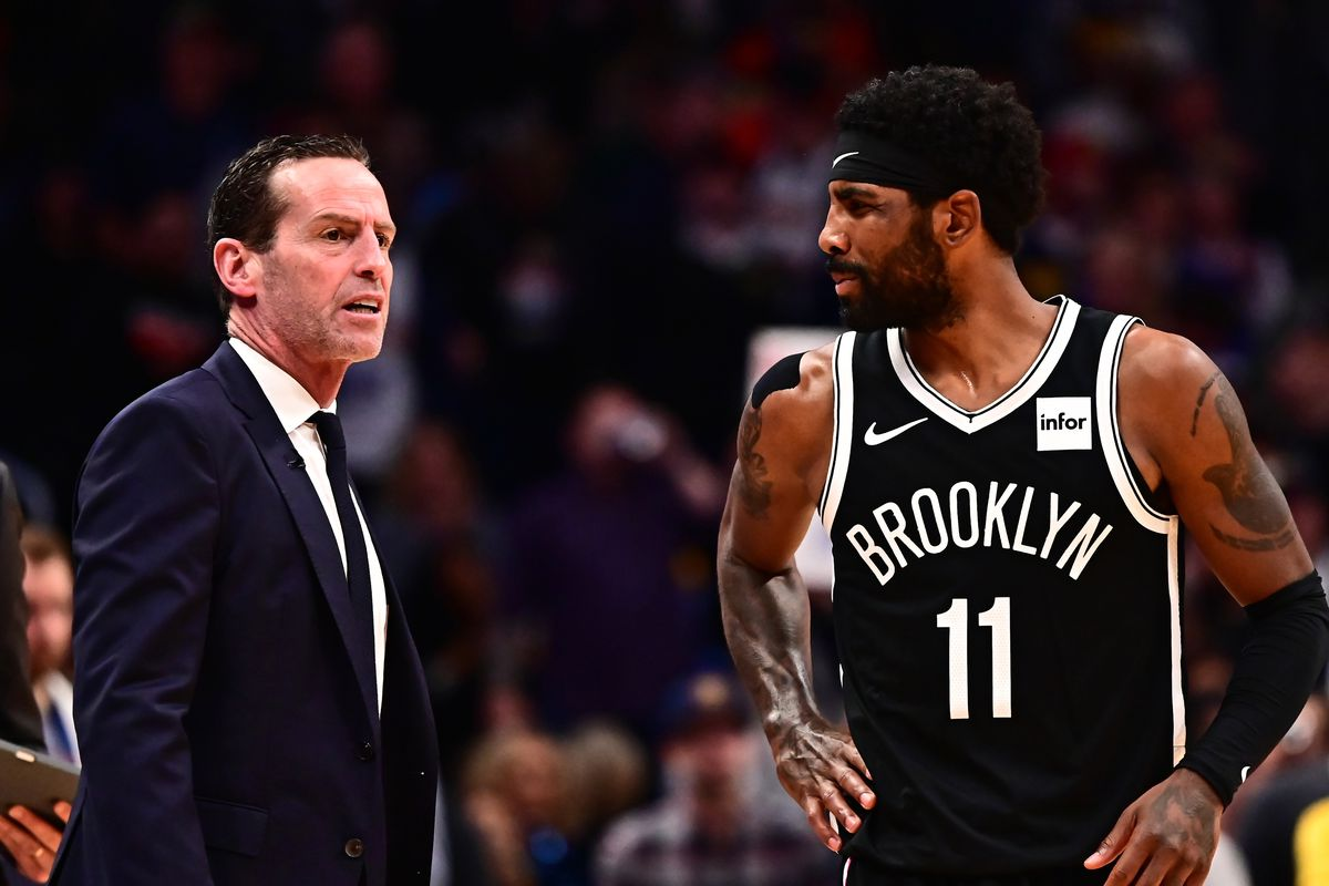 Brooklyn Net head coach Kenny Atkinson and guard Kyrie Irving talk in the fourth quarter against the Denver Nuggets at the Pepsi Center.