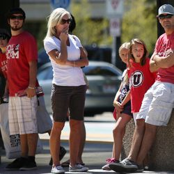 University of Utah fans wait to board TRAX at the Courthouse Station in Salt Lake City on Saturday, Sept. 6, 2014.