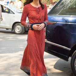 Kate kicked off the third day of her trip in this affordable ($78!) red maxi dress from high street brand Glamorous — accessorized with a red tika spot, a floral garland, and suede Russell & Bromley flats — for a visit to a boys' charity in Delhi.