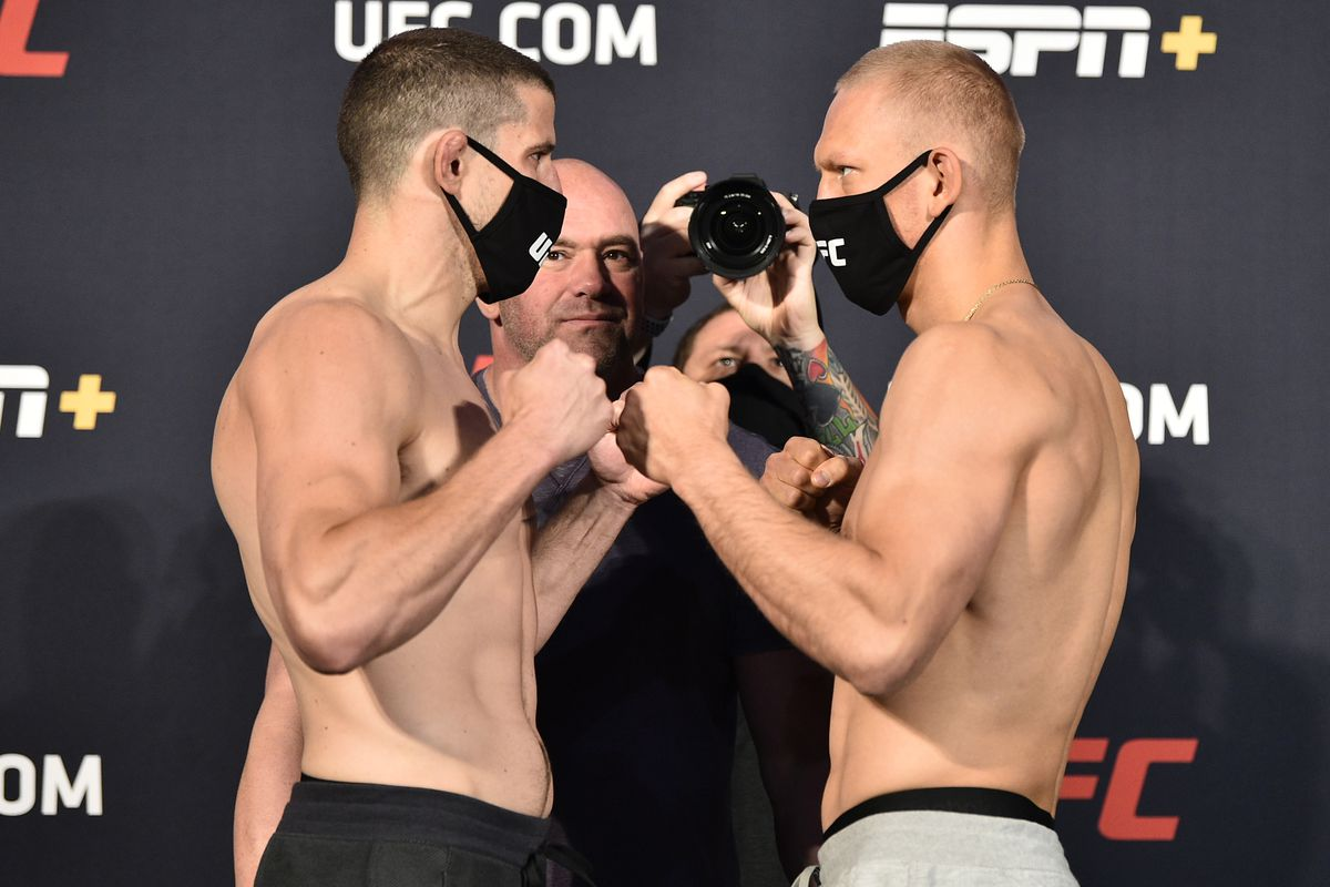 In this handout image provided by UFC, opponents Marc-Andre Barriault of Canada and Oskar Piechota of Poland face off during the UFC weigh-in at UFC APEX on June 19, 2020 in Las Vegas, Nevada.