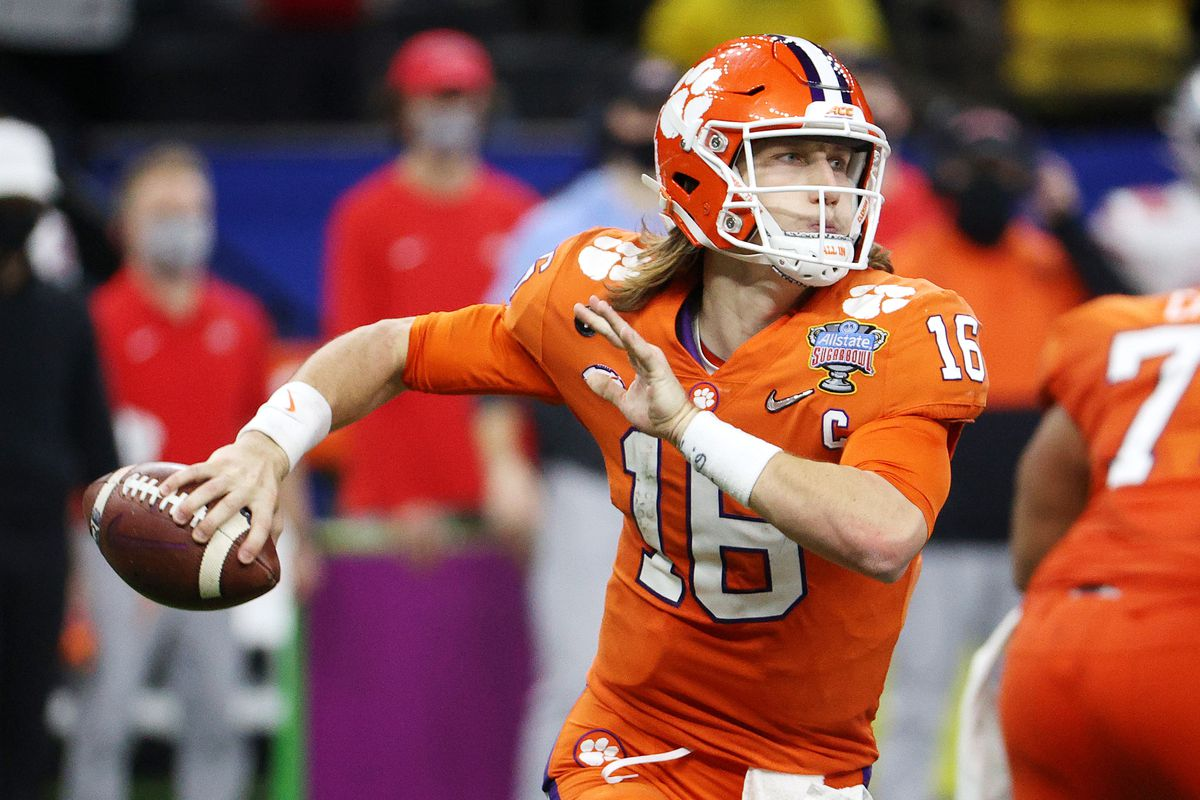 Trevor Lawrence #16 of the Clemson Tigers looks to pass in the second half against the Ohio State Buckeyes during the College Football Playoff semifinal game at the Allstate Sugar Bowl at Mercedes-Benz Superdome on January 01, 2021 in New Orleans, Louisiana.