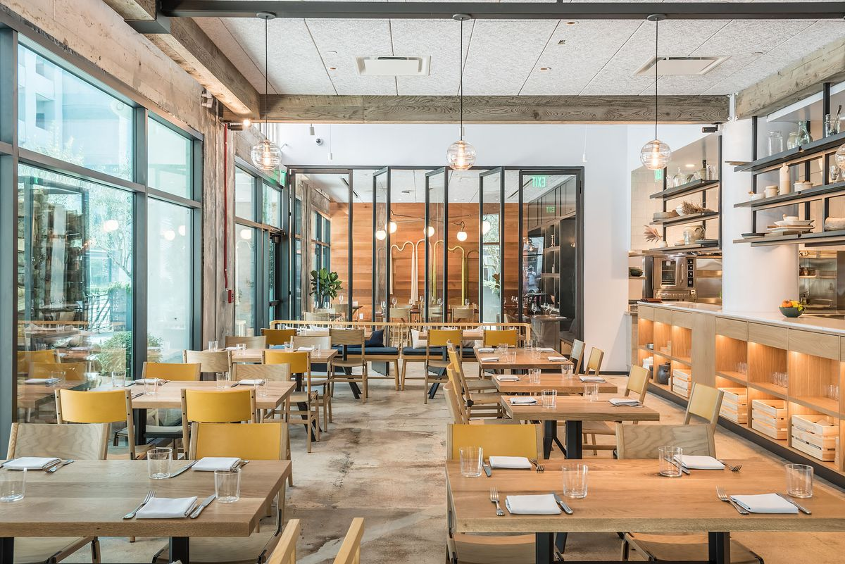 Open warehouse restaurant M. Georgina with tall windows at Row in Downtown Los Angeles
