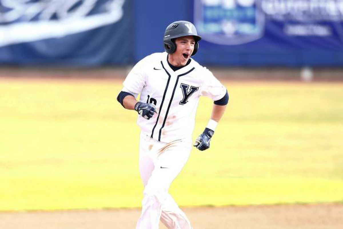 BYU Baseball sophomore short stop Daniel Schneemann celebrating a big hit while rounding the bases.