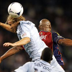 KANSAS CITY, KS - APRIL 14:  Chance Myers #7 of Sporting Kansas City battles Jamison Olave #4 of Real Salt Lake for the ball during the Major League Soccer game on April 14, 2012 at Livestrong Sporting Park in Kansas City, Kansas.  (Photo by Jamie Squire/Getty Images)