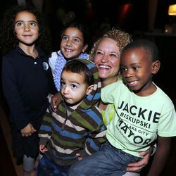 Salt Lake mayoral candidate Jackie Biskupski poses for a photo with children, including son Archie, right, during her election night party in Sugar House on Tuesday, Nov. 3, 2015.