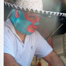 Mexican wrestler serving off of the Tamale Spaceship.