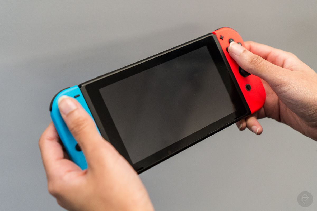 Nintendo Switch with Joy-Cons in hands