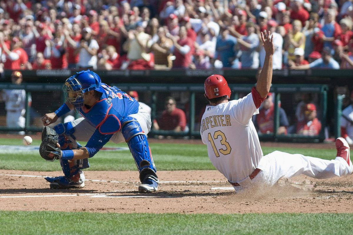 St. Louis, MO. USA; St. Louis Cardinals first baseman Matt Carpenter slides safely into home plate as Chicago Cubs catcher Geovany Soto fields the throw in the fourth inning at Busch Stadium. Credit: Jeff Curry-US PRESSWIRE