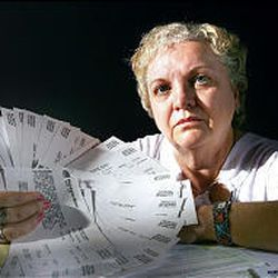 Patty Bailey holds dozens of bounced-check notices from her bank. She could not afford to pay off the loans she obtained from payday loan centers.