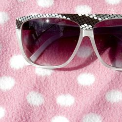 A pair of sunglasses is displayed for sale Sunday at the Swap Meet in West Valley City. The swap meet is held on Saturdays and Sundays.