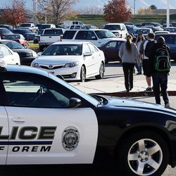 Students and parents leave Mountain View High School in Orem on Tuesday, Nov. 15, 2016, after five students were stabbed in an apparent attack by a 16-year-old boy.