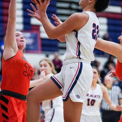 Woods Cross' Sofia Mokofisi goes to the hoop against Murray's Taelyr Overby in a 5A girls basketball first-round game in Woods Cross on Tuesday, Feb. 18, 2020.