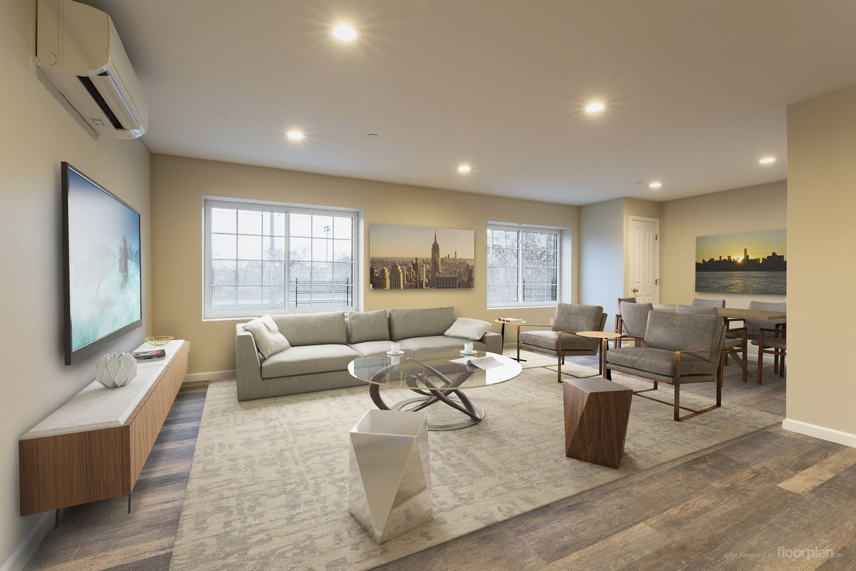 A living room with hardwood floors, large windows, yellow walls, a glass coffee table, two chairs, and a couch.