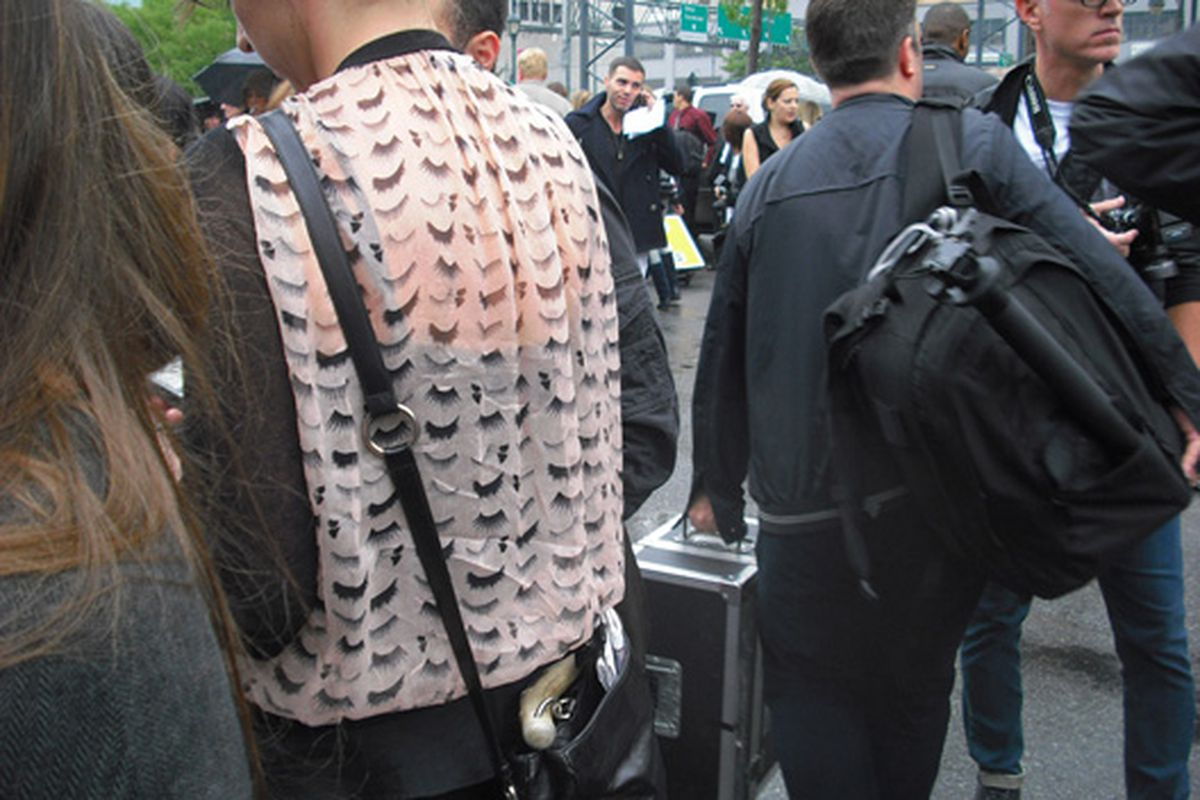 """A vest covered with eyelashes outside the tents.  Image via <a href=""""http://www.flickr.com/photos/sinceagain/3927170678/in/pool-rackedny"""">SINCEAGAIN</a>/Racked Flickr Pool"""