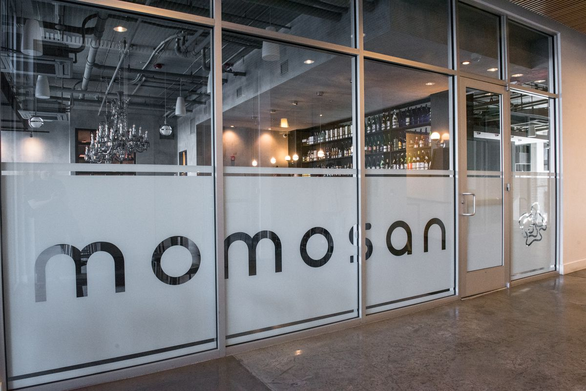 A view of the Momosan sign from outside looking into the bar.