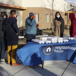 Salt Lake City Mayor Erin Mendenhall, center, meets with people from Neighborhood House and the Nourish to Flourish food program at Neighborhood House in Salt Lake City on Tuesday, Dec. 22, 2020. Mendenhall was there to help distribute food.