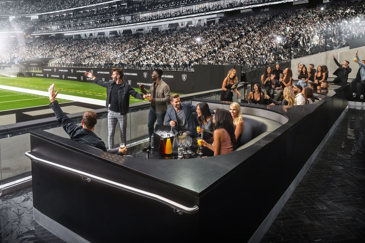 A nightclub filled with people in the end zone of a football stadium