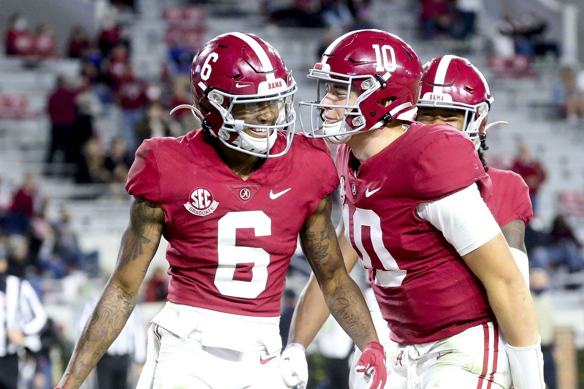 Alabama wide receiver DeVonta Smith (6) and Alabama quarterback Mac Jones (10) celebrate a touchdown pass from Jones to Smith at Bryant-Denny Stadium during the second half of Alabama's 41-0 win over Mississippi State.