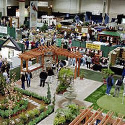 Visitors to the home improvement show check out the wide assortment of booths.