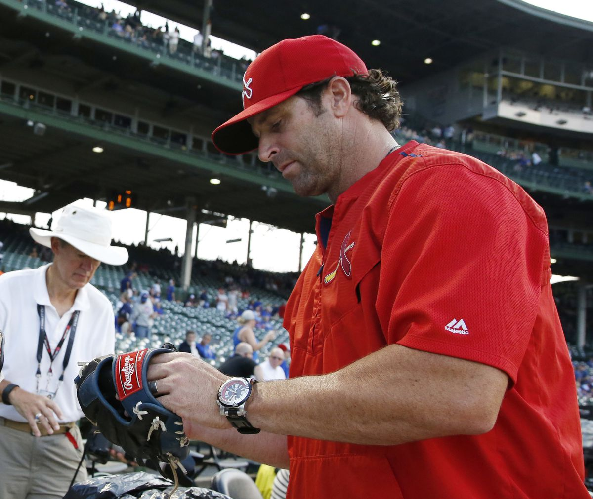St. Louis Cardinals manager Mike Matheny and his watch. | Nam Y. Huh/AP