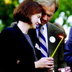 Lois and Ed Smart attend a candlelight vigil for Elizabeth at Liberty Park in June 2002. Thousands attended in support of the family.