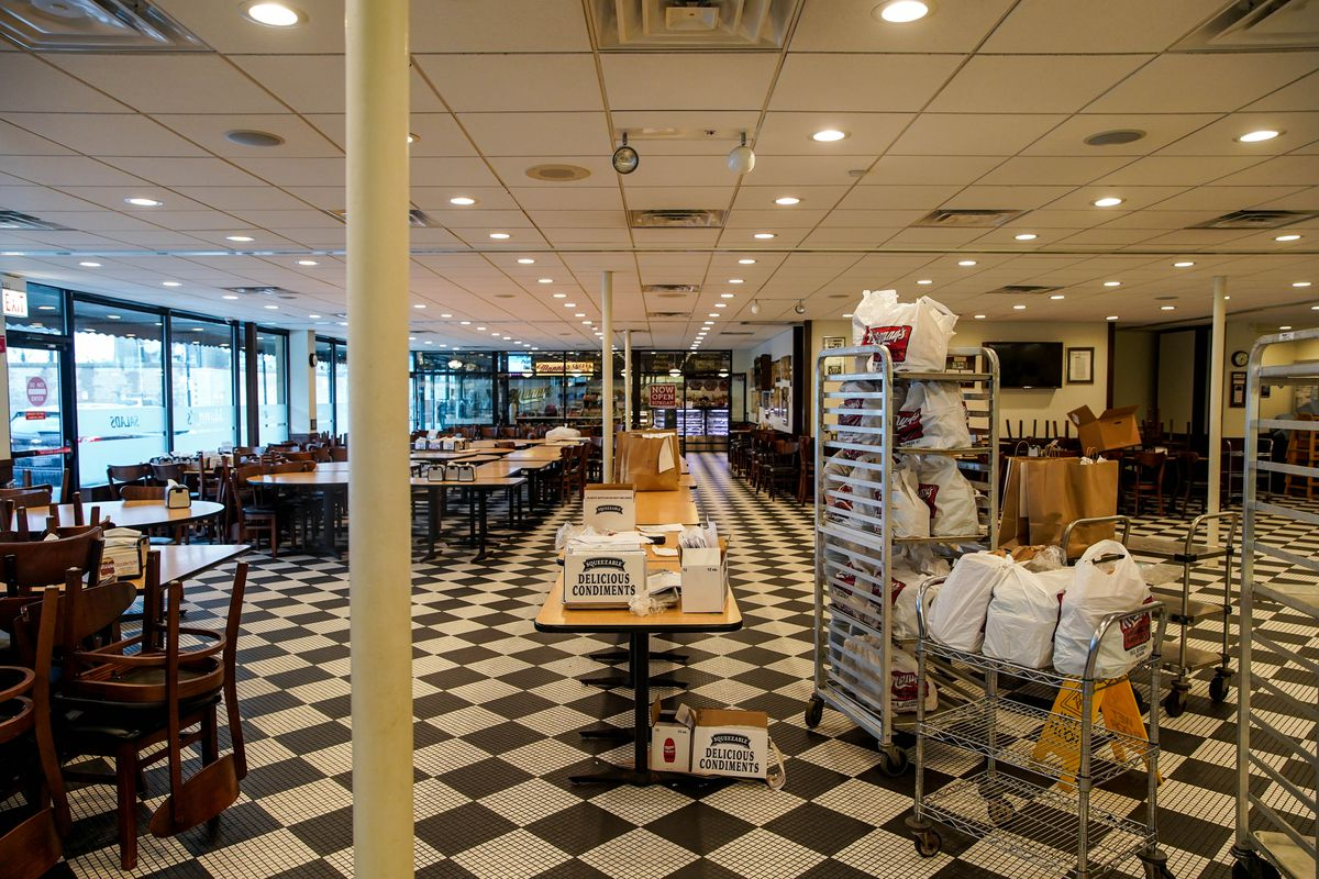 Manny's Deli is mostly empty other than carryout orders waiting to be picked up on Wednesday.