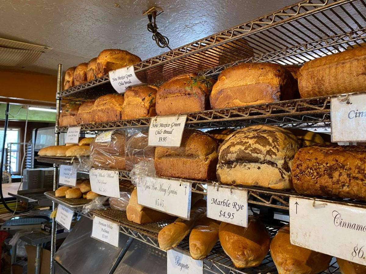 Wire shelves of bread for sale with labels