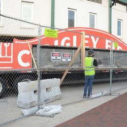 2:24 p.m. The two halves of the marquee on the flatbed truck -