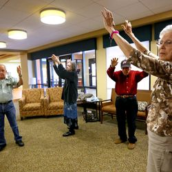 From left, Denver Carder, Barbara Wardle, David Dowdle and Idora Meier participate in Tai Chi at Sagewood at Daybreak Assisted Living in South Jordan on Tuesday, Aug. 9, 2016. Wardle, Dowdle and Meier are Alzheimer patients.