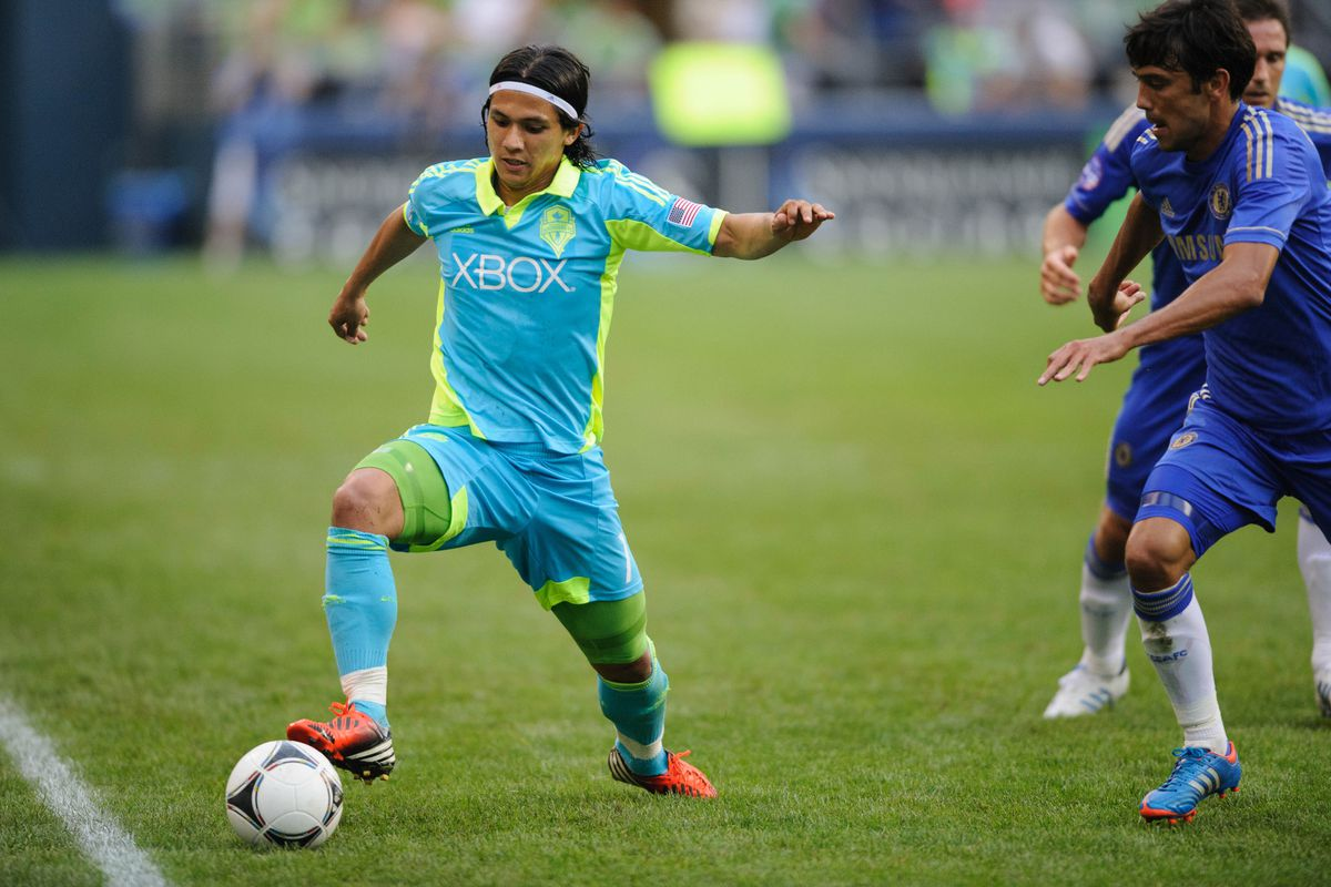 Jul 18, 2012; Seattle, WA, USA; Seattle Sounders FC forward Fredy Montero (17) keeps the ball inbounds during the 2nd half against Chelsea FC at CenturyLink Field. Chelsea FC defeated Seattle 4-2. Mandatory Credit: Steven Bisig-US PRESSWIRE
