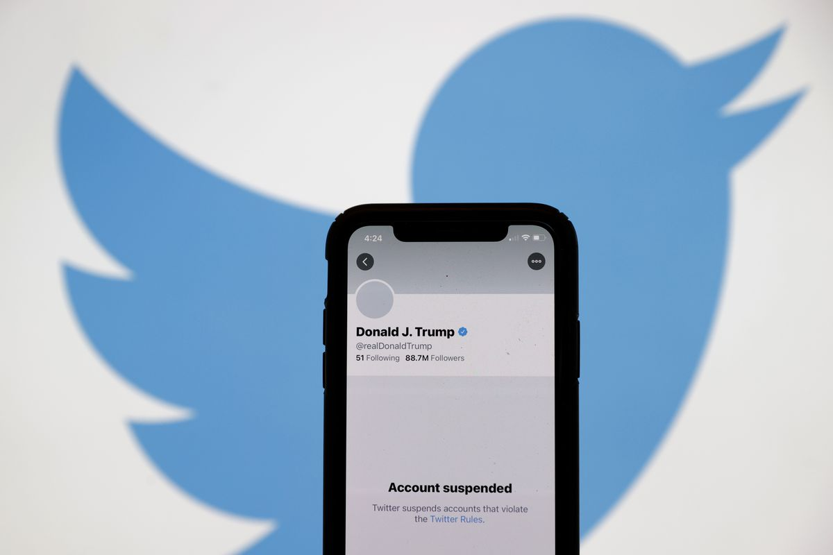 The suspended Twitter account of President Donald Trump appears on an iPhone screen on January 8, 2021.