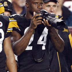 Pittsburgh Steelers cornerback Ike Taylor shoots pictures from the sidelines during the preseason NFL football game.