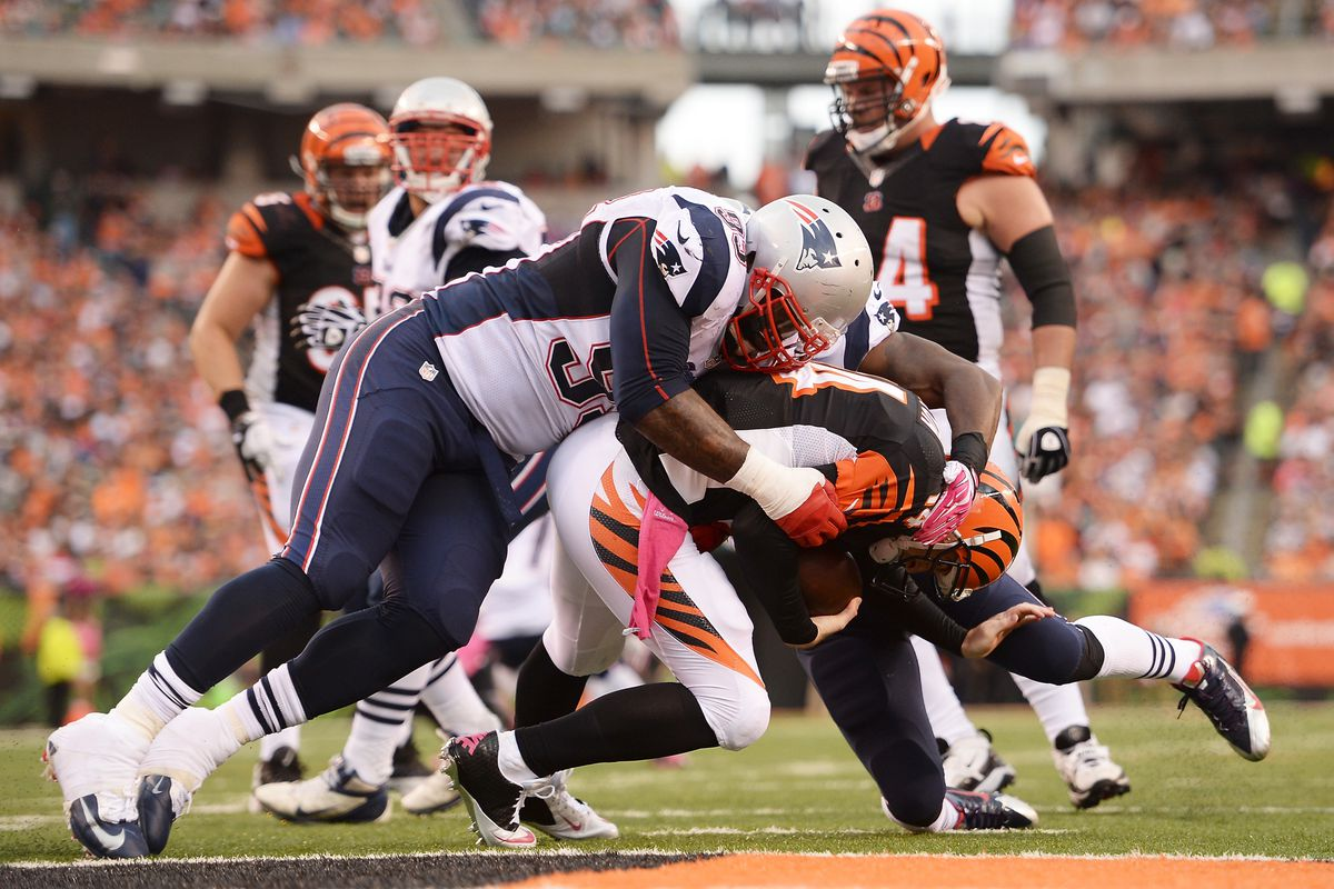 Tommy Kelly makes the sack on Andy Dalton