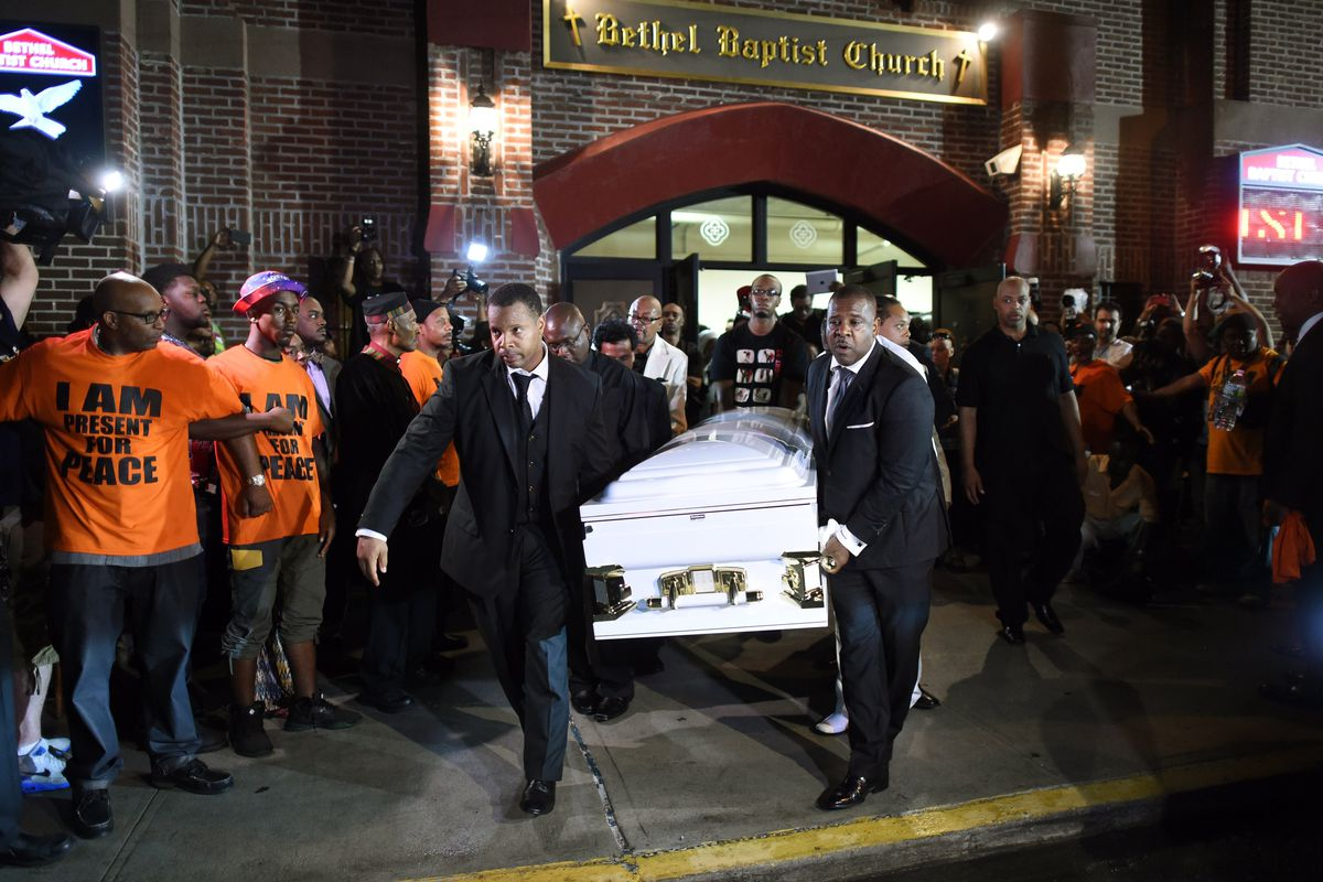 Pallbearers carry Eric Garner's casket